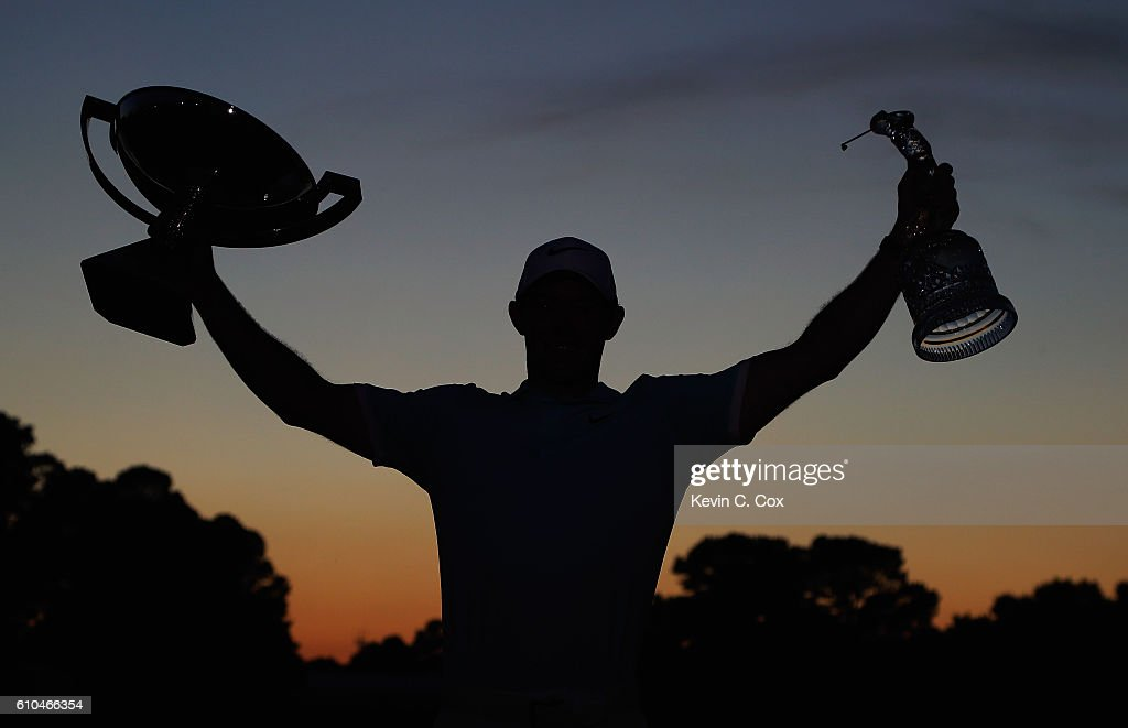 Rory McIlroy of Northern Ireland poses with the FedExCup and TOUR Championship trophies after his victory over Ryan Moore with a birdie on the fourth extra hole during the TOUR Championship at East Lake Golf Club on September 25, 2016 in Atlanta, Georgia.