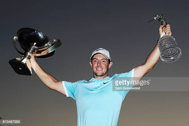 Rory McIlroy of Northern Ireland poses with the FedExCup and TOUR Championship trophies after his victory over Ryan Moore with a birdie on the fourth...