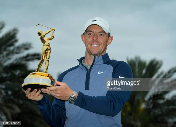 Rory McIlroy of Northern Ireland poses with THE PLAYERS Championship Trophy after winning THE PLAYERS Championship on THE PLAYERS Stadium Course at...