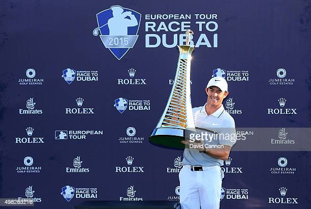 Rory McIlroy of Northern Ireland poses with the Race to Dubai trophy after his one shot win in the final round of the 2015 DP World Tour Championship...