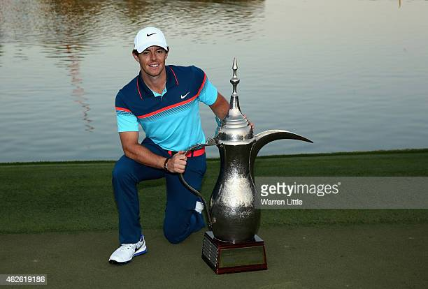 Rory McIlroy of Northern Ireland poses with the trhophy after winning the Omega Dubai Desert Classic on the Majlis Course at the Emirates Golf Club...