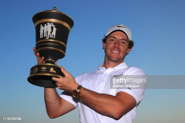 Rory McIlroy of Northern Ireland poses with the trophy after his victory in a playoff during Day Four of the WGC HSBC Champions at Sheshan...