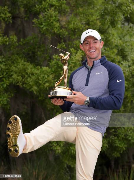 Rory McIlroy of Northern Ireland poses with the trophy after securing victory during the final round of The PLAYERS Championship on March 17, 2019 in...