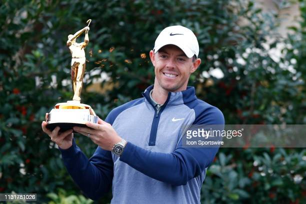 Rory McIlroy of Northern Ireland poses with the trophy after winning THE PLAYERS Championship on March 17 2019 on the Stadium Course at TPC Sawgrass...