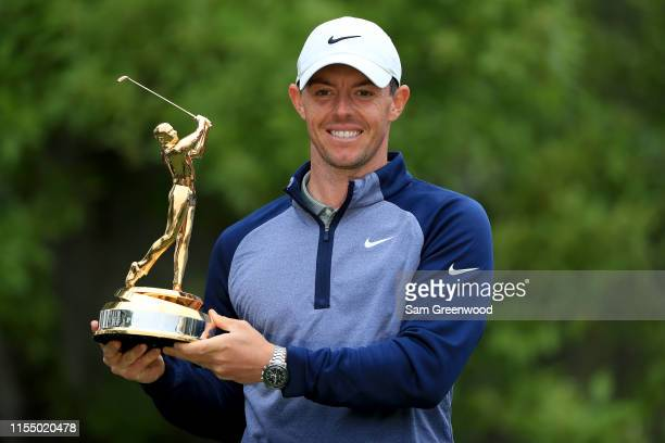 Rory McIlroy of Northern Ireland poses with the trophy after winning The PLAYERS Championship at the TPC Stadium course on March 17 2019 in Ponte...