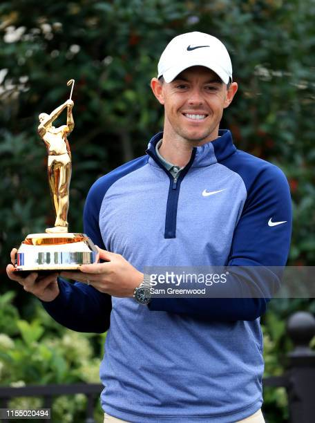 Rory McIlroy of Northern Ireland poses with the trophy after winning The PLAYERS Championship at the TPC Stadium course on March 17, 2019 in Ponte...