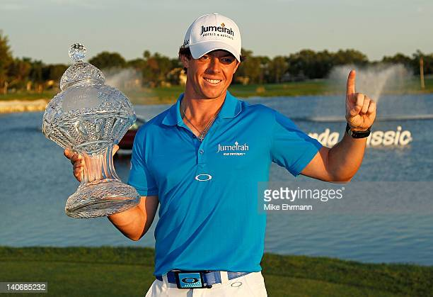 Rory McIlroy of Northern Ireland poses with the trophy after winning the Honda Classic at PGA National on March 4 2012 in Palm Beach Gardens Florida