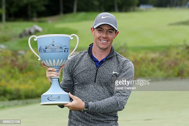 Rory McIlroy of Northern Ireland poses with the trophy during the final round of the Deutsche Bank Championship at TPC Boston on September 5, 2016 in...