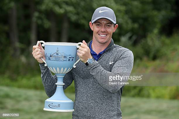 Rory McIlroy of Northern Ireland poses with the trophy during the final round of the Deutsche Bank Championship at TPC Boston on September 5 2016 in...