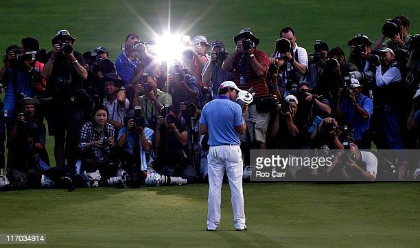 Rory McIlroy of Northern Ireland poses with the trophy for photographers after his eight-stroke victory on the 18th green during the 111th U.S. Open...