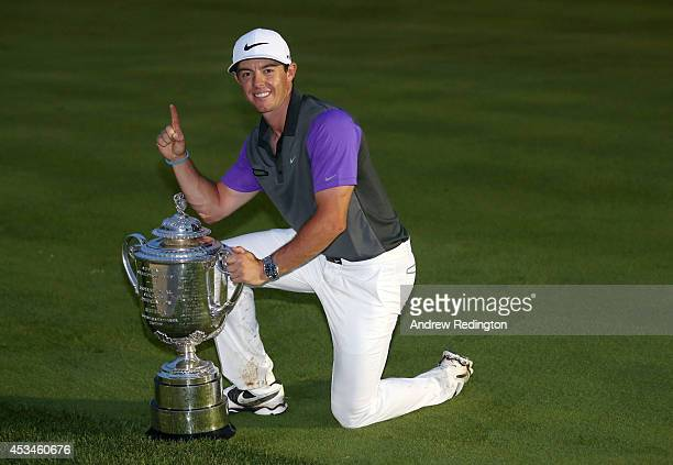 Rory McIlroy of Northern Ireland poses with the Wanamaker trophy after his one-stroke victory during the final round of the 96th PGA Championship at...