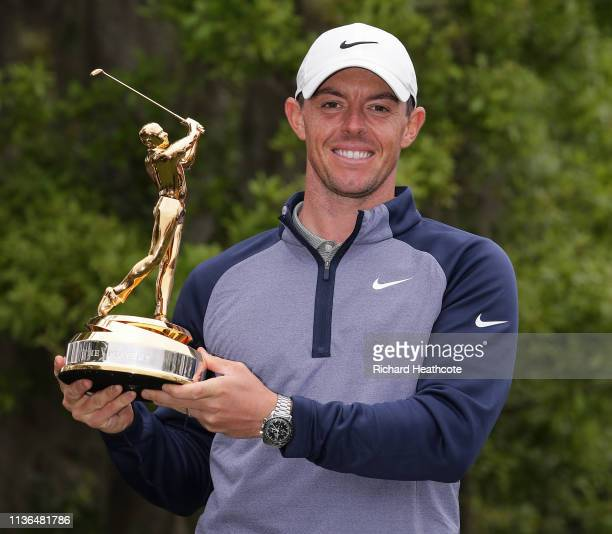 Rory McIlroy of Northern Ireland poses with the winner's trophy after winning The PLAYERS Championship on The Stadium Course at TPC Sawgrass on March...
