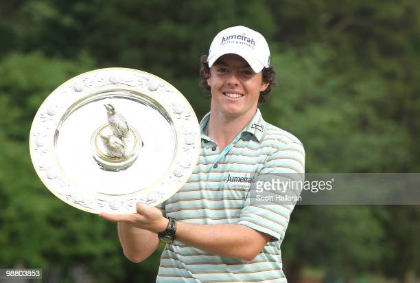 Rory McIlroy of Northern Ireland poses with the winner's trophy after his fourstroke victory at the 2010 Quail Hollow Championship at the Quail...