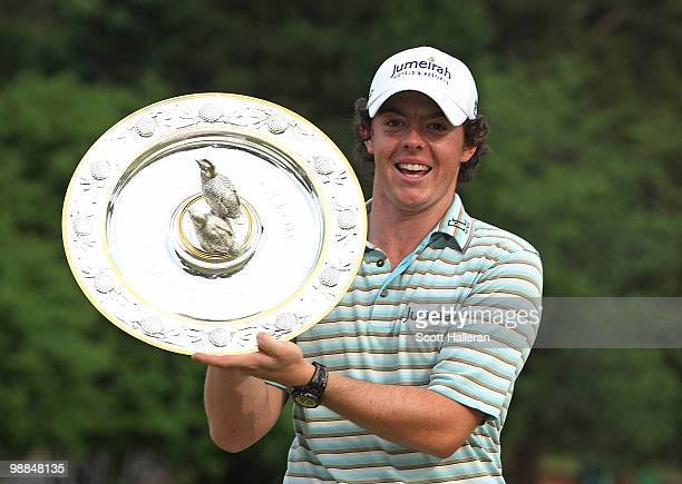 Rory McIlroy of Northern Ireland poses with the winner's trophy after his four-stroke victory at the 2010 Quail Hollow Championship at the Quail...