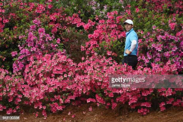 Rory McIlroy of Northern Ireland prepares to play a shot out of the flowers on the 13th hole during the third round of the 2018 Masters Tournament at...