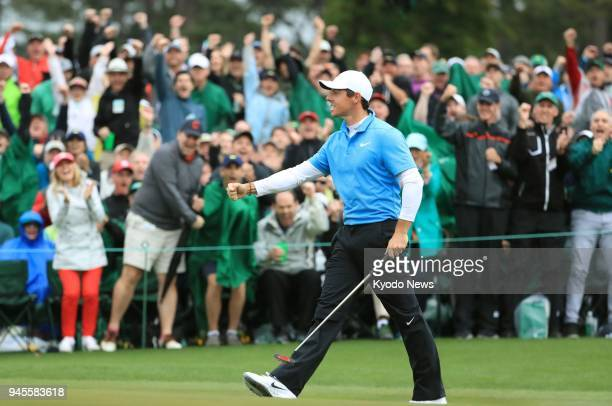 Rory McIlroy of Northern Ireland pumps his fist after making birdie on the 18th hole during the third round of the Masters golf tournament in Augusta...
