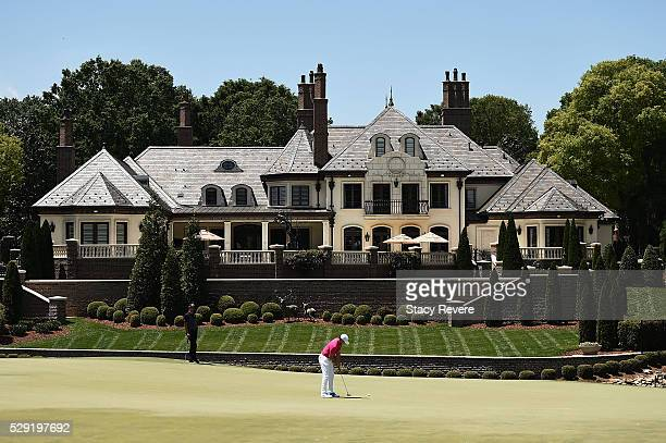 Rory McIlroy of Northern Ireland putts for birdie on the seventh green during the final round of the Wells Fargo Championship at Quail Hollow Club on...