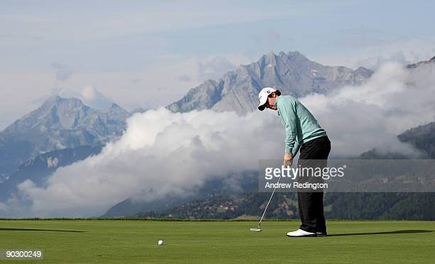 Rory McIlroy of Northern Ireland putts on the 7th green during the Pro Am prior to the start of The Omega European Masters at CransSurSierre Golf...