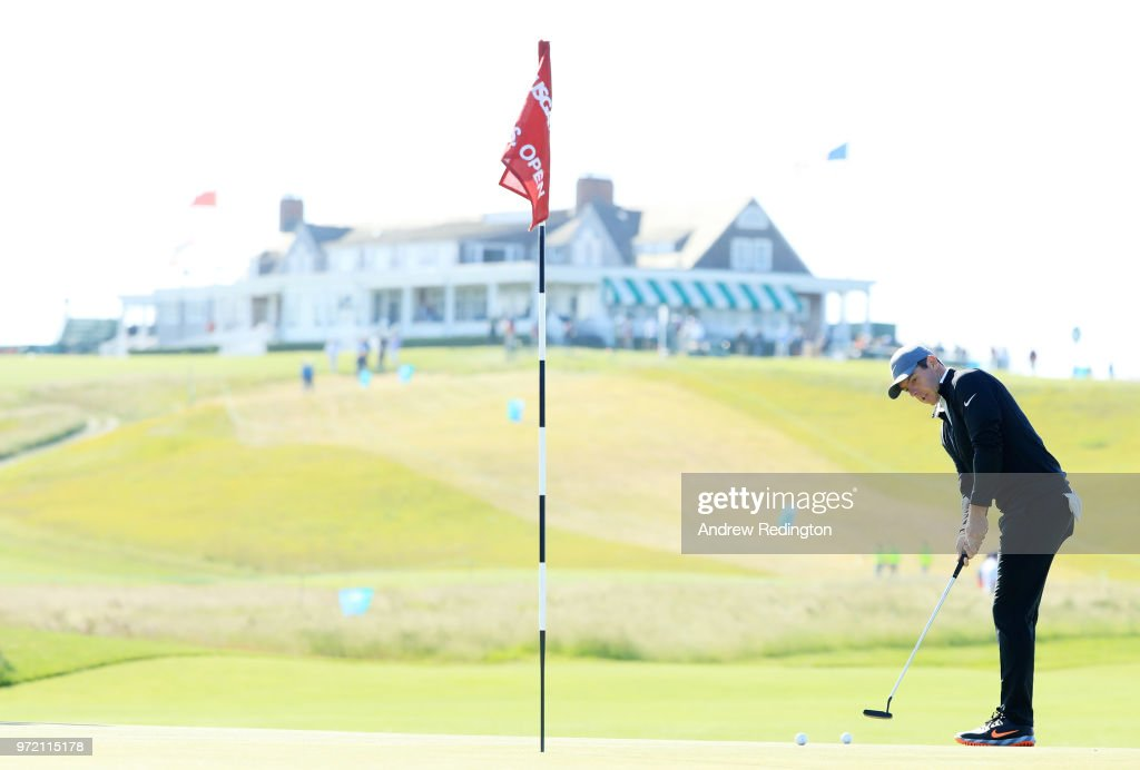 Rory McIlroy of Northern Ireland putts on the first green during a practice round prior to the 2018 U.S. Open at Shinnecock Hills Golf Club on June 12, 2018 in Southampton, New York.