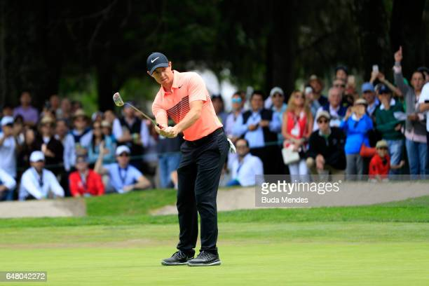 Rory McIlroy of Northern Ireland putts on the ninth hole during the third round of the World Golf Championships Mexico Championship at Club De Golf...