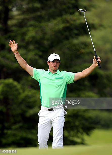 Rory McIlroy of Northern Ireland raises his arms on the 9th green after finishing his 18 rounds during the opening day of the Irish Open at the Fota...