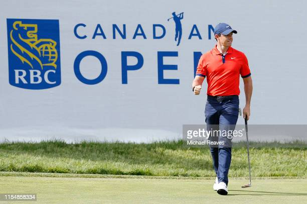 Rory McIlroy of Northern Ireland reacts after a birdie putt on the 14th green during the final round of the RBC Canadian Open at Hamilton Golf and...