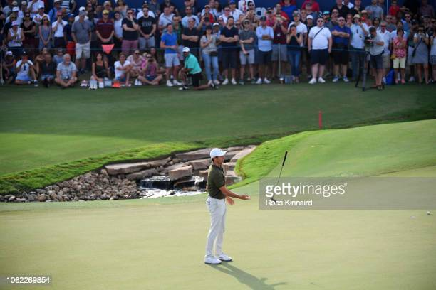 Rory McIlroy of Northern Ireland reacts after a putt on the 18th green during day two of the DP World Tour Championship at Jumeirah Golf Estates on...