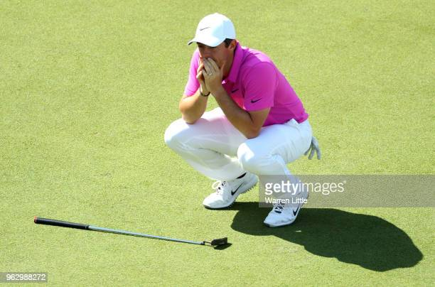 Rory McIlroy of Northern Ireland reacts after a putt on the 18th green during day four and the final round of the BMW PGA Championship at Wentworth...