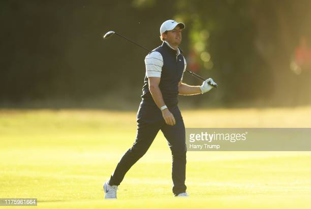 Rory McIlroy of Northern Ireland reacts after his second shot on the seventeeth during Day 2 of the BMW PGA Championship at Wentworth Golf Club on...