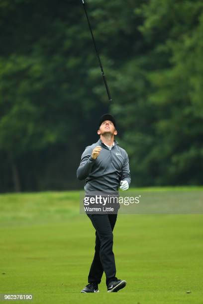 Rory McIlroy of Northern Ireland reacts after his second shot on the seventeenth during day two of the BMW PGA Championship at Wentworth on May 25...