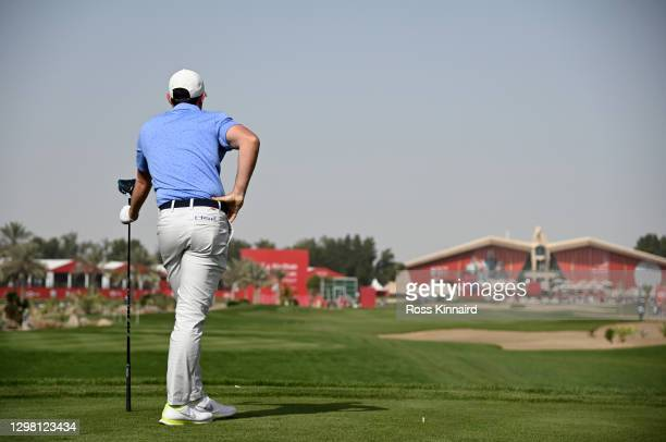 Rory McIlroy of Northern Ireland reacts after his shot on the 9th tee during the final round of the Abu Dhabi HSBC Championship at Abu Dhabi Golf...