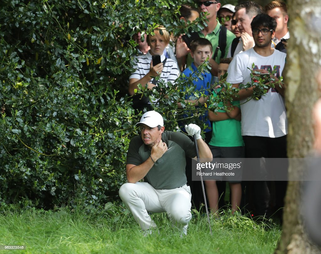 Rory McIlroy of Northern Ireland reacts after hitting a spectator on the 6th hole during the third round of the BMW PGA Championship at Wentworth on May 26, 2018 in Virginia Water, England.