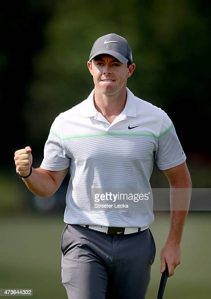 Rory McIlroy of Northern Ireland reacts after making a birdie putt on the 16th hole during round three at the Wells Fargo Championship at Quail...