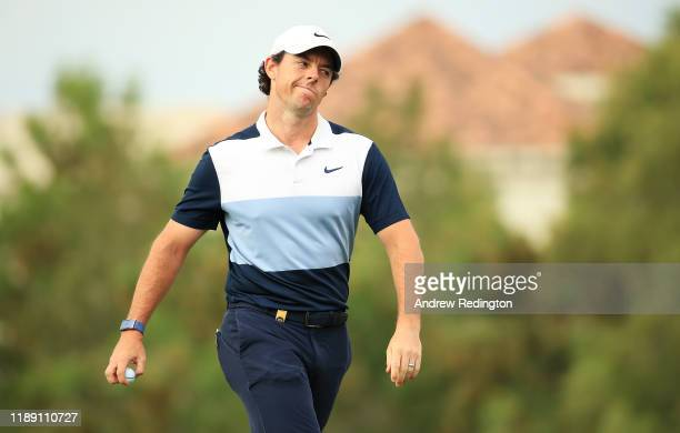 Rory McIlroy of Northern Ireland reacts after making a bogey on the 12th hole during Day One of the DP World Tour Championship Dubai at Jumeirah Golf...