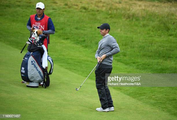 Rory McIlroy of Northern Ireland reacts after playing a shot on the 18th green during the second round of the 148th Open Championship held on the...