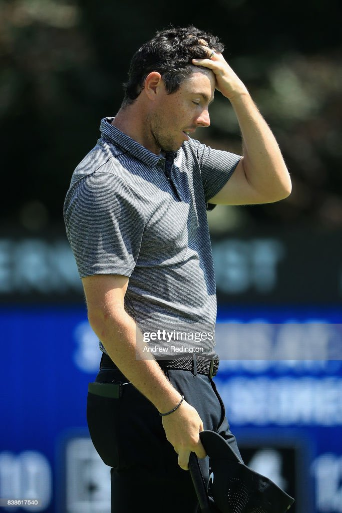 Rory McIlroy of Northern Ireland reacts after putting on the 18th green during round one of The Northern Trust at Glen Oaks Club on August 24, 2017 in Westbury, New York.