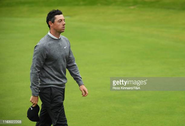 Rory McIlroy of Northern Ireland reacts as he walks off the 18th hole following his second round of the 148th Open Championship held on the Dunluce...