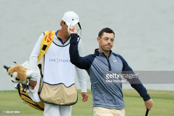 Rory McIlroy of Northern Ireland reacts as he walks to the 18th green during the final round of The PLAYERS Championship on The Stadium Course at TPC...
