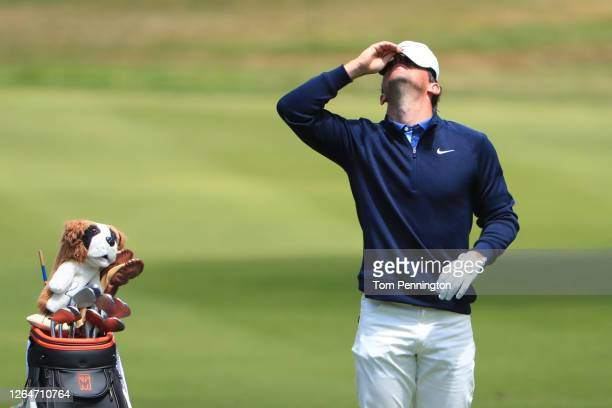 Rory McIlroy of Northern Ireland reacts before playing an approach shot on the fifth hole during the third round of the 2020 PGA Championship at TPC...