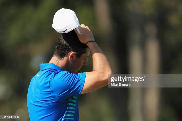 Rory McIlroy of Northern Ireland reacts on the 11th hole during the second round of THE PLAYERS Championship on the Stadium Course at TPC Sawgrass on...