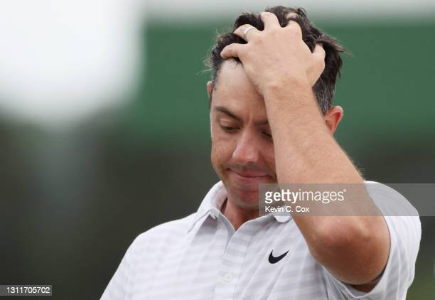 Rory McIlroy of Northern Ireland reacts on the 18th green during the second round of the Masters at Augusta National Golf Club on April 09, 2021 in...