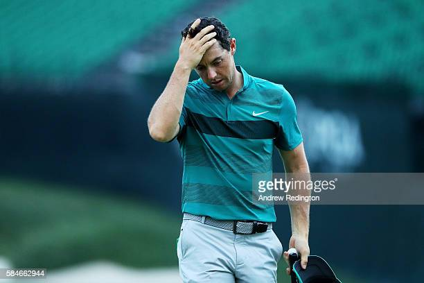Rory McIlroy of Northern Ireland reacts on the 18th green during the second round of the 2016 PGA Championship at Baltusrol Golf Club on July 29,...