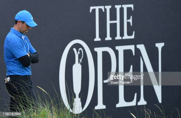 Rory McIlroy of Northern Ireland reacts on the 18th hole during the first round of the 148th Open Championship held on the Dunluce Links at Royal...
