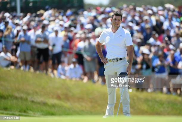 Rory McIlroy of Northern Ireland reacts on the ninth green during the first round of the 2018 US Open at Shinnecock Hills Golf Club on June 14 2018...