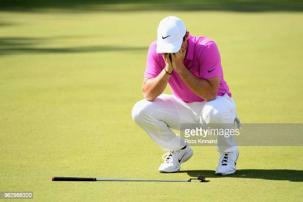 Rory McIlroy of Northern Ireland reacts to a missed eagle putt on the 18th green during the final round of the BMW PGA Championship at Wentworth on...