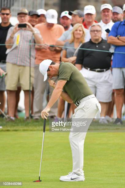 Rory McIlroy of Northern Ireland reacts to a missed putt on the ninth green during the second round of the BMW Championship at Aronimink Golf Club on...
