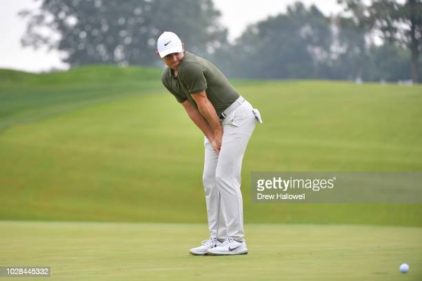 Rory McIlroy of Northern Ireland reacts to a missed putt on the eighth green during the second round of the BMW Championship at Aronimink Golf Club...