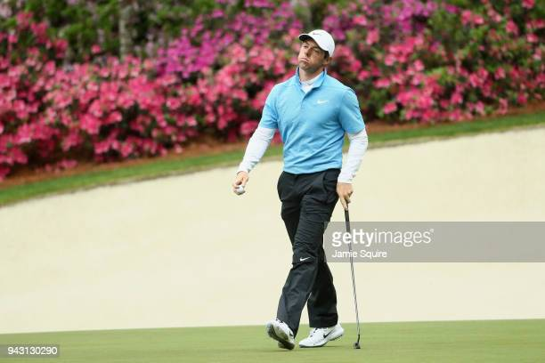 Rory McIlroy of Northern Ireland reacts to a putt on the 13th green during the third round of the 2018 Masters Tournament at Augusta National Golf...