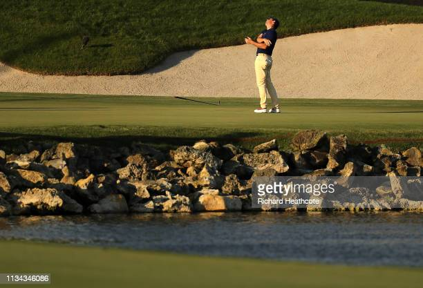 Rory McIlroy of Northern Ireland reacts to a putt on the 18th green during the first round of the Arnold Palmer Invitational Presented by Mastercard...