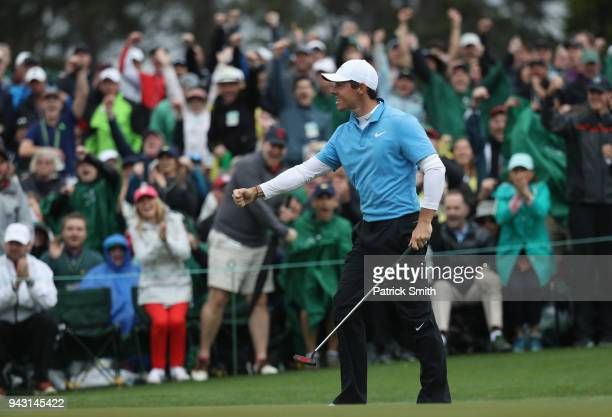 Rory McIlroy of Northern Ireland reacts to a putt on the 18th green during the third round of the 2018 Masters Tournament at Augusta National Golf...